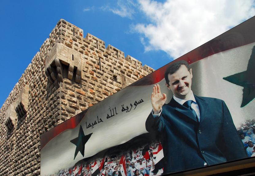 Cartaz com o presidente da Síria, Bashar al-Assad, em Damasco (imagem: iStock)