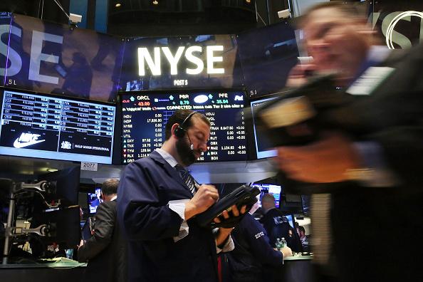 Economistas auxiliam investidores de bolsas de valores (Créditos: Getty Images)