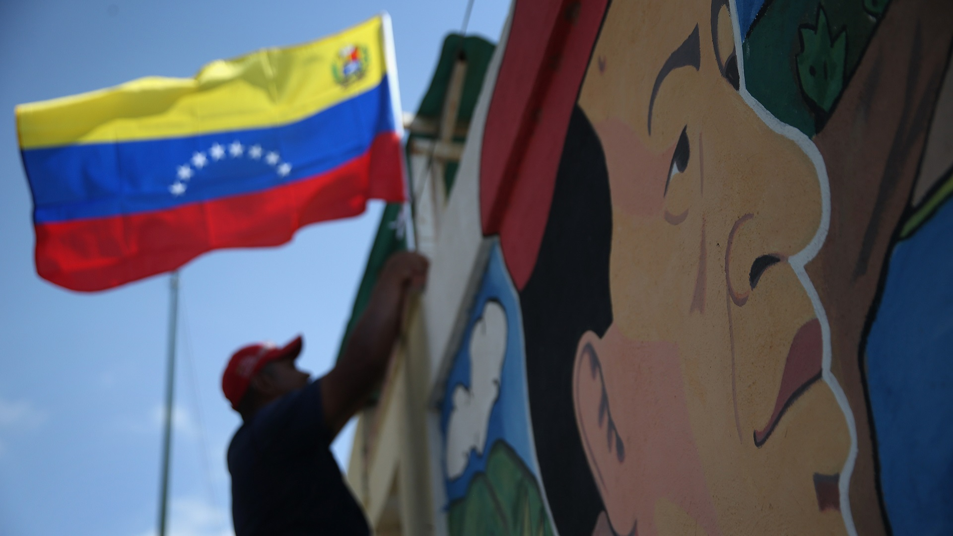 Venezuelans Loyal To Former President Hugo Chavez Prepare To Mark One Year Anniversary Of His Death
