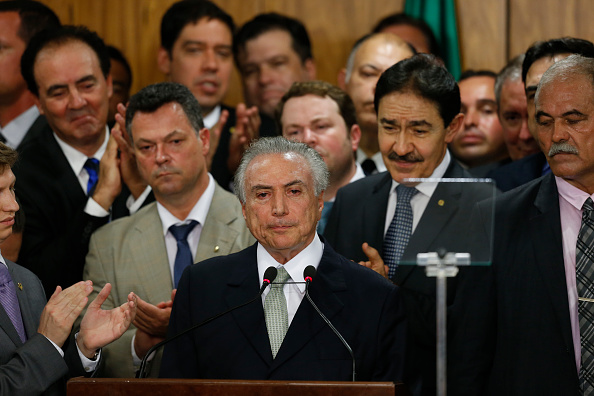BRASILIA, BRAZIL - MAY 12: Brazil's interim President Michel Temer (C) attends a signing ceremony for new government ministers at the Planalto presidential palace after the Senate voted to accept impeachment charges against suspended President Dilma Rousseff on May 12, 2016 in Brasilia, Brazil. Rousseff has been suspended from her presidential duties and will face a Senate trial for alleged manipulation of government accounts. (Photo by Igo Estrela/Getty Images)